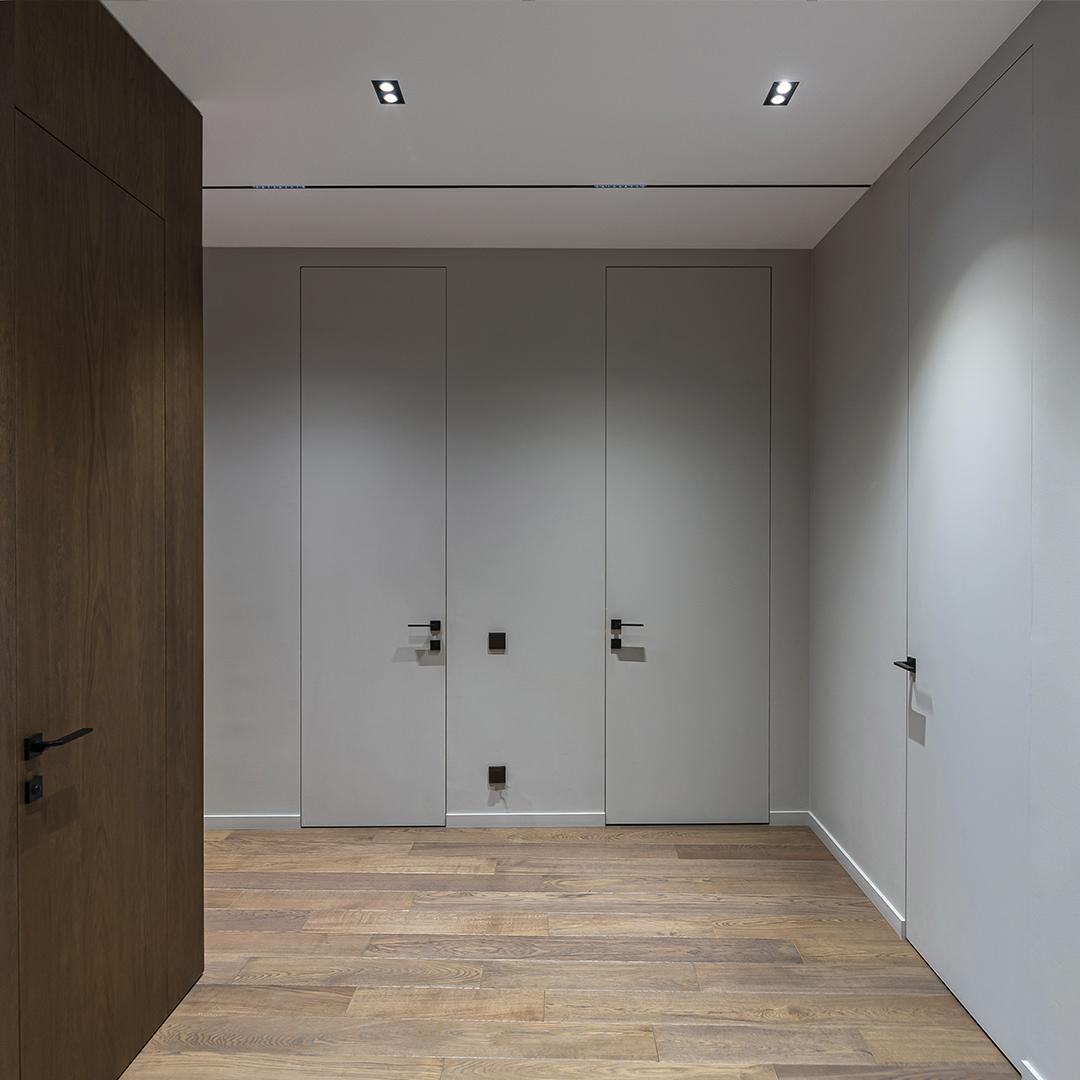Скрытые двери под покраску и полотна-невидимки в теле панелей